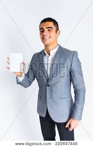 Stylish Guy Buttoning A Button In Studio