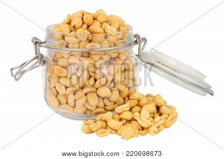 Roasted peanuts in a glass storage jar isolated on a white background
