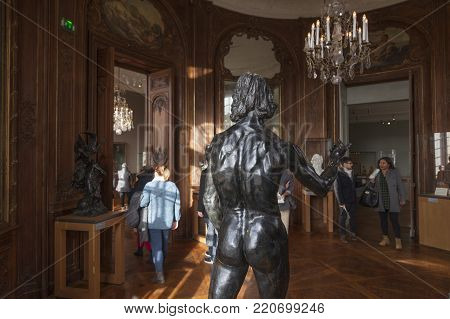 Paris, 30 december 2017: sculpture by rodin and people inside musee rodin in paris