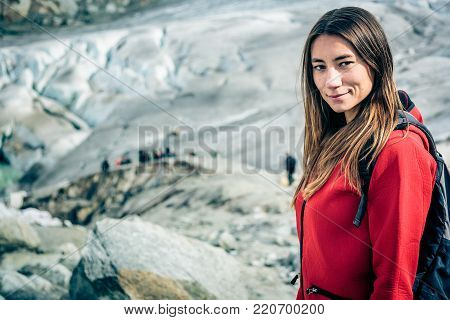 Young Woman Hiking in the Swiss Alps. Shot taken in Swiss Alps, near Rhone Glacier and Furka Pass.