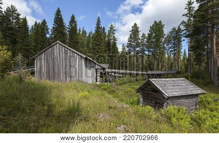 INDAL, SWEDEN ON JULY 22. View of a beautiful wooden homestead, buildings on July 22, 2017 in Gudmundstjarn, Sweden. Rustic old timber, log sawmill and warehouses. Editorial use.