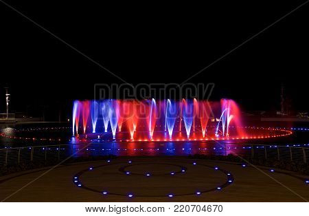 Kalkara, MALTA - 17 jul, 2015: singing fountains on night time in Smart City Malta, Kalkara, Malta island, Europe. Colorful fountains in Smart City Malta