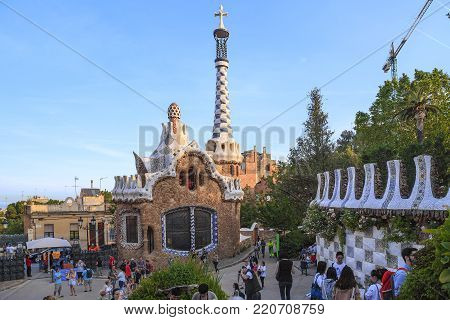 BARCELONA, SPAIN - MAY 16, 2017: This is a fabulous Administration Pavilion in Güell Park, which is filled with unidentified visitors.