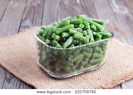 Frozen string beans in a glass box on a table