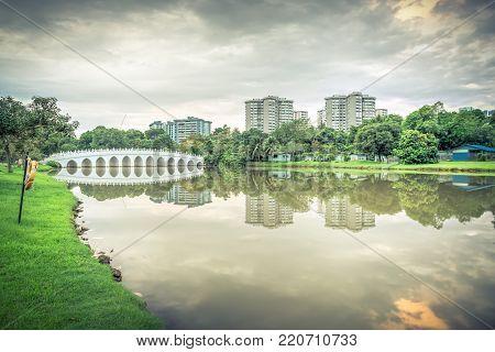 Reflection Of New Estate Hdb Housing Complex On Jurong Lake, Singapore