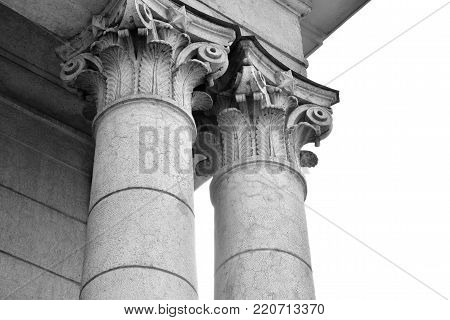 The capitals of the columns. Black and white.