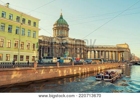 SAINT PETERSBURG, RUSSIA - AUGUST 15, 2017. Kazan cathedral and Griboedov channel in Saint Petersburg, Russia. Vintage tones applied. City view of Saint Petersburg Russia landmarks