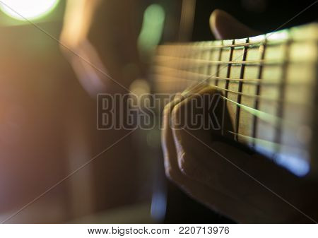 Guitarist bass on stage for background, colorful, soft focus and blur