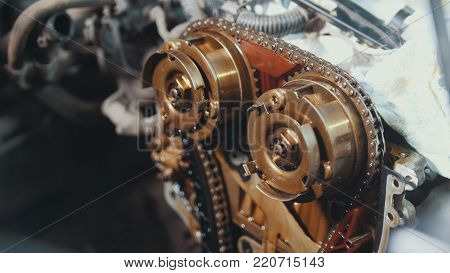 The internal combustion engine, repair at car service, details under the hood of the car, close-up