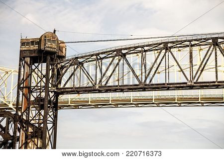 Sault Ste Marie, Michigan, USA - August 9, 2015: Control tower of the historic International Railroad Bridge between Sault Ste Marie, Michigan and Sault Ste Marie, Ontario.