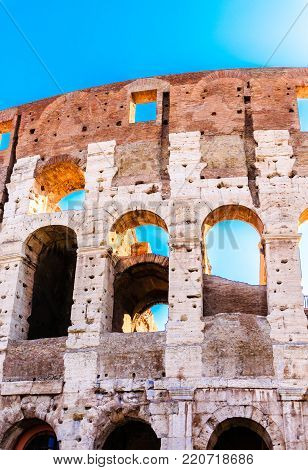 Three Open Arches on the Colloseum under blue Sky