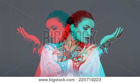 Sexy oriental belly dancer performer in double exposure style