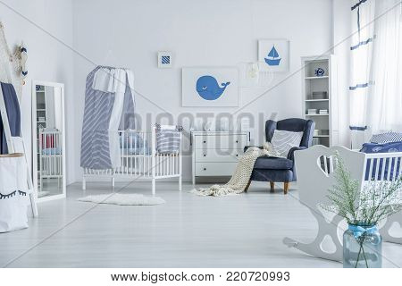 Spacious Baby's Room With Crib