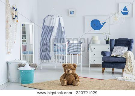 Striped Cushion On Blue Armchair