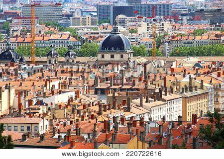 Aerial view of Lyon downtown with red roofs and chimneys