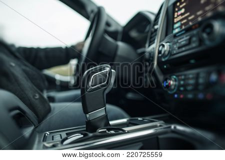Modern Car Driving Theme. Vehicle Interior with Automatic Transmission Shifter.