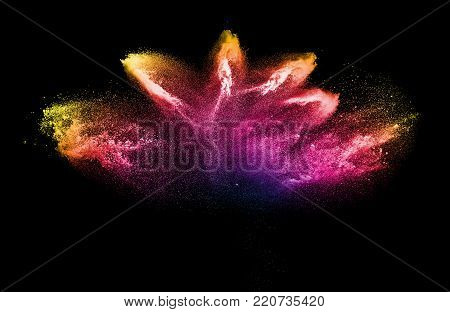 Bizarre forms of powder painted and flour combined explode in front of a black background to give off fantastic colors and forms.