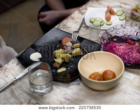Unfinished food on the uncleared table, indoor closeup