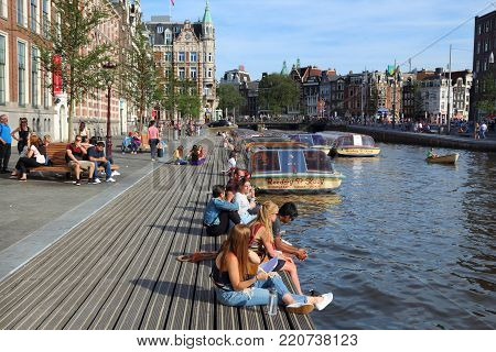 Amsterdam, Netherlands - July 9, 2017: People Visit Rokin Canal In Amsterdam, Netherlands. Amsterdam