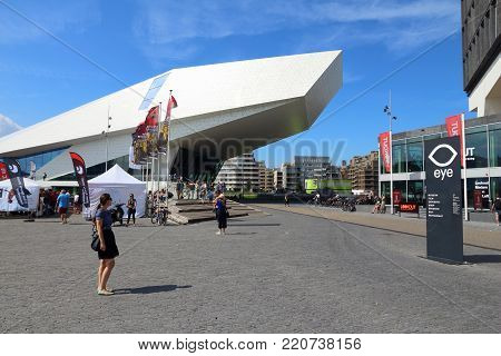 Amsterdam, Netherlands - July 9, 2017: People Walk In Front Of Eye Film Institute Netherlands In Ams