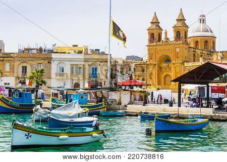 MARSAXLOKK, MALTA - June 28, 2017: Mediterranean traditional colorful boats in Malta