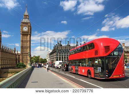 LONDON, UK - JULY 7, 2016: People walk along Westminster Bridge near Big Ben in London, UK. London is the most populous city in the UK with 13 million people living in its metro area.