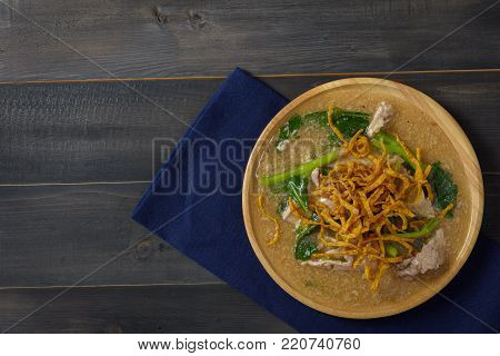 Noodles in Thick Gravy (Rad Na) on the wooden table, Thai local food, Top view with copy space