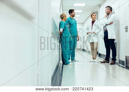 Medical Doctor Explaining X-ray Result To Patient
