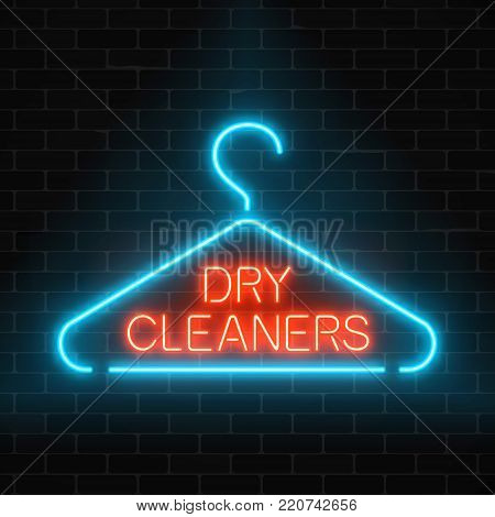 Neon dry cleaners glowing sign with hanger on a dark brick wall background. Cleaning service signboard design. Vector illustration