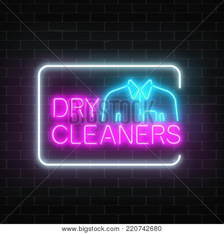 Neon dry cleaners glowing sign with shirt in rectangle frame on a dark brick wall background. Cleaning service signboard design.Vector illustration