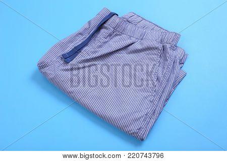 Foled casual short pants on blue pastel background