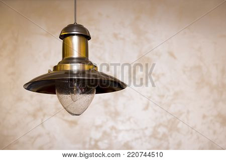 metal plafond with lamp hanging on the ceiling.Copy space