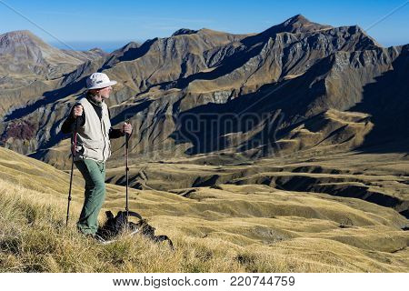GREECE - OCTOBER 16, 2017: A man hikes on Mt Gramos on October 16, 2017 in Greece. Mt Gramos is one of the highest mountains of Greece.