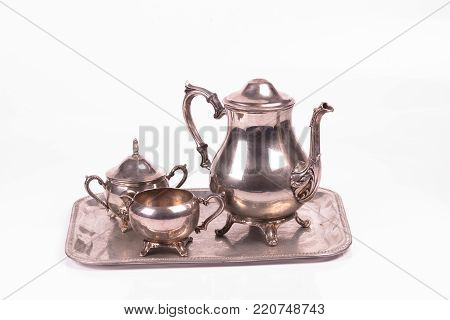 handcrafted art deco tea pot set over a white background