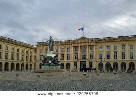 Reims, France - December 26, 2017: Royal Square (place royale) with building of Prefecture and Louis XV bronze monument erected in 1818 in Reims