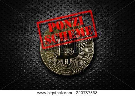 Gold bitcoin with Ponzi Scheme stamp, on grunge rivet metal background