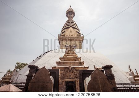 Swayambhunath is an ancient religious architecture atop a hill in the Kathmandu Valley. The Swayambhunath complex consists of a stupa, a variety of shrines and temples.