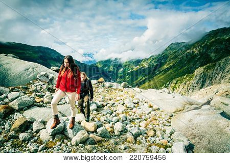 Young Couple Made it to the Top. Shot taken in Swiss Alps, near Rhone Glacier and Furka Pass.