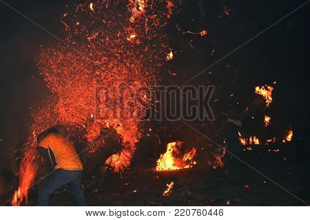 The tradition of annual ritual torch warfare. the beauty of sparks. amazing fire.