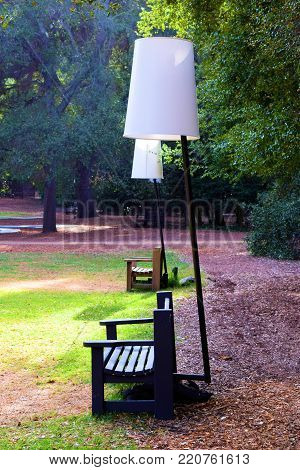 January 1, 2018 in La Crescenta, CA:  Contemporary art structure including a lamp over a bench taken at the Descano Gardens in La Crescenta, CA where people can visit this botanical garden and see many plant species and contemporary art sculptures