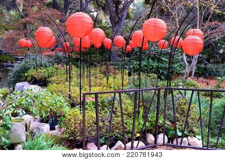 January 1, 2018 in La Crescenta, CA:  Red Lanterns at The Garden of Good Fortune taken at the Descano Gardens in La Crescenta, CA where people can visit an authentic Japanese Zen Garden with plants native to Japan and Japanese architectural design