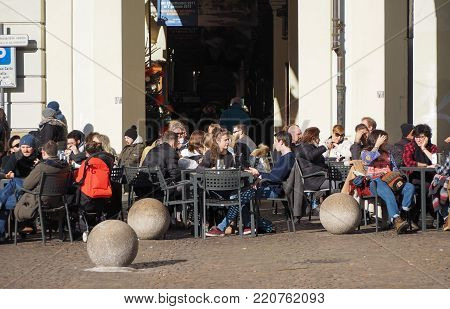 TURIN, ITALY - CIRCA JANUARY 2018: People in the city centre at alfresco bar in Piazza Vittorio square