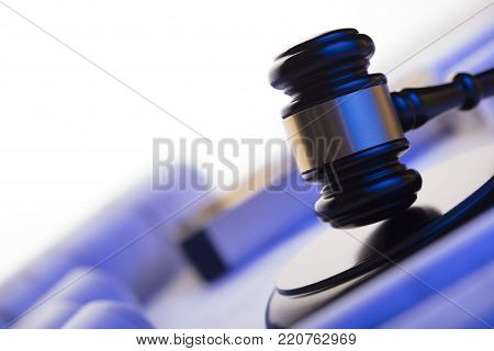 Labor and construction law concept. Gavel, helmet and blueprints.