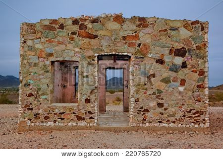 The ghostly rock cabin of Joseph Cone who lived in the town of Quartzsite Arizona from 1892 to 1971. This rock cabin is now registered as a historical landmark and is on public land. No property release is necessary.