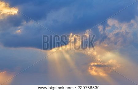 sunset sky with the light of the sun behind