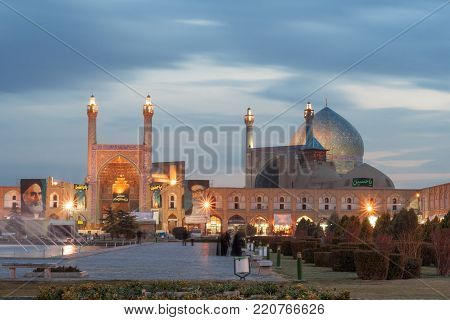 Isfahan, January 7: The decoration of Imam Mosque with Naqsh-e Jahan Square after Dark on January 7, 2009 at Isfahan, Iran. Built during the Safavid period as Shah Abbas Mosque.  Night view on Imam Mosque in Esfahan. Water pool with many fountains and lig