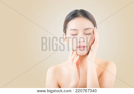 Beautiful girl with makeup, woman portrait and skin care cosmetic concept / attractive beauty asian girl on face on yellow background.