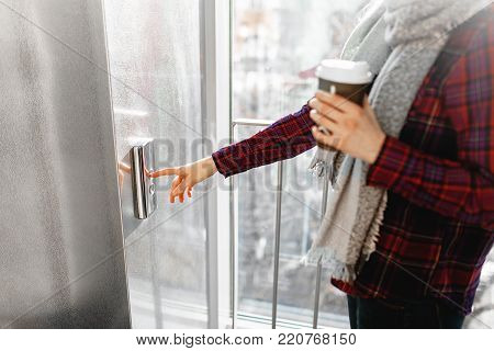 The thumb presses the Elevator button, a hand reaching for the button, the girl waiting for Elevator, push button start, isolated, the girl with the jar of coffee