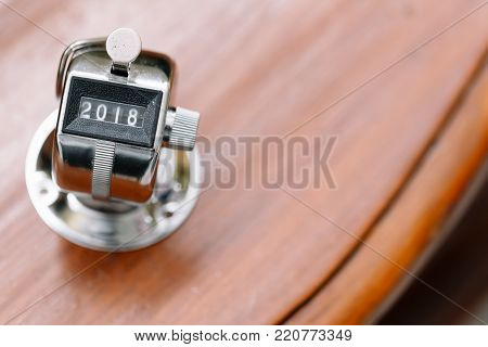 Concept Of Happy New Year 2018 Celebration. Number Hand Tally Counter Stop At 2018 On White Table Wi