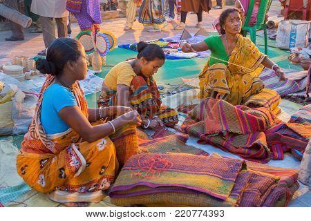 KOLKATA, WEST BENGAL , INDIA - DECEMBER 3RD 2016 : Unidentified women preparing jute bags, artworks of handicraft, Handicraft Fair in Kolkata - the biggest handicrafts fair in Asia.
